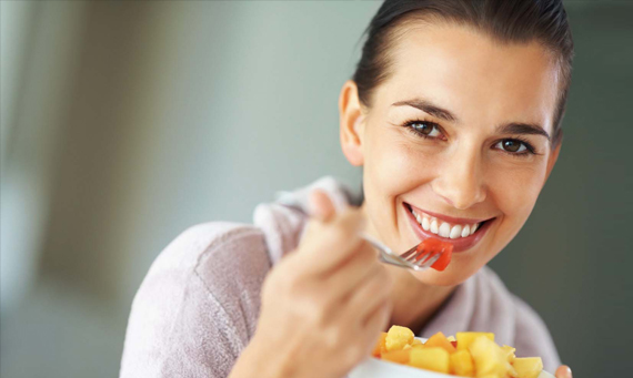 Happy Woman with Fruit on HCG Diet